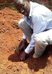 Photo of Rev John Mark Oduor planting from Newsletter April 2017