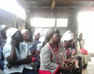 Women listen during a one day seminar that REAP staff facilitated at Evangelical Christ Church in Africa (ECCA)
