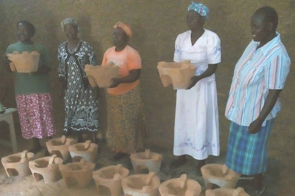 The women showing off their recently made clay liners