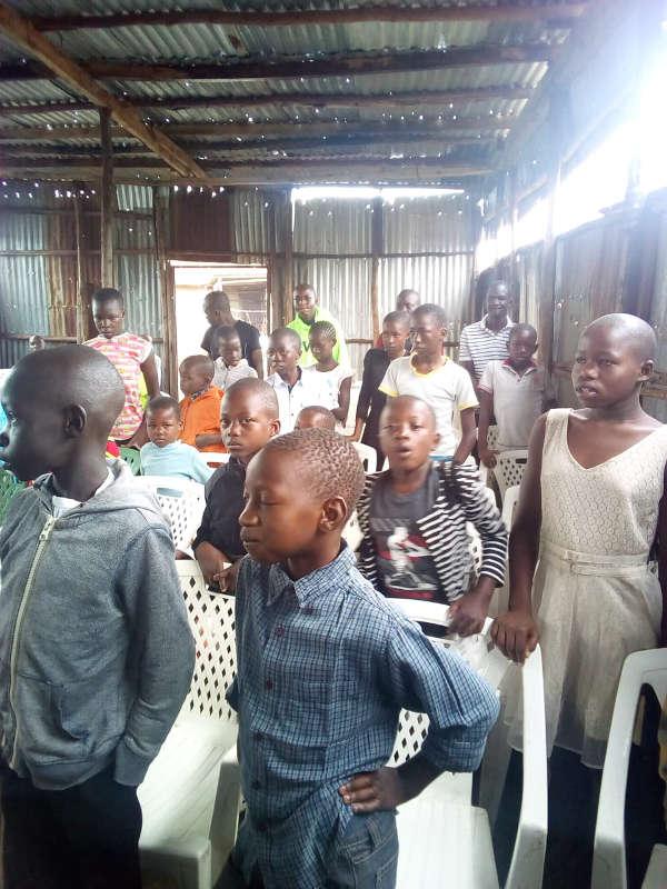 Children standing in a classroom